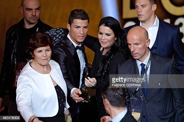 Real Madrid's Portuguese forward Cristiano Ronaldo celebrates with his mother Dolores Aveiro and sister Katia after receiving the Ballon d'Or award...