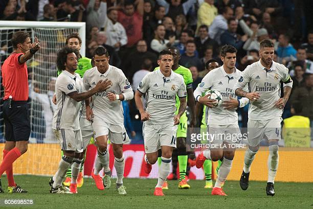 Real Madrid's Portuguese forward Cristiano Ronaldo celebrates with his teammates after scoring during the UEFA Champions League football match Real...
