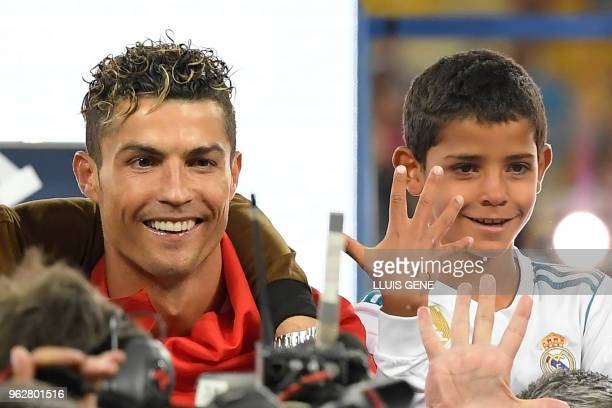 Real Madrid's Portuguese forward Cristiano Ronaldo celebrates with his son Cristiano junior after winning the UEFA Champions League final football...