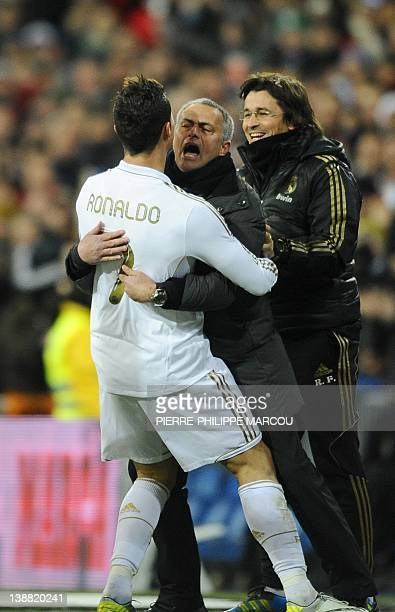 Real Madrid's Portuguese forward Cristiano Ronaldo celebrates with Real Madrid's Portuguese coach Jose Mourinho after scoring during the Spanish...