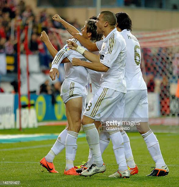 Real Madrid's Portuguese forward Cristiano Ronaldo celebrates with teammates after scoring during the Spanish league football match Atletico Madrid...