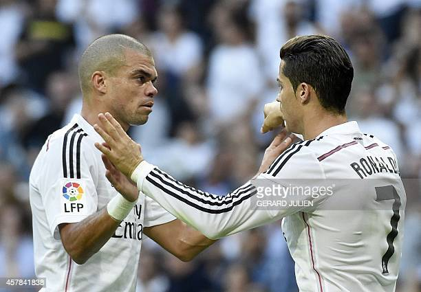 Real Madrid's Portuguese forward Cristiano Ronaldo celebrates with Real Madrid's Portuguese defender Pepe after scoring during the Spanish league...