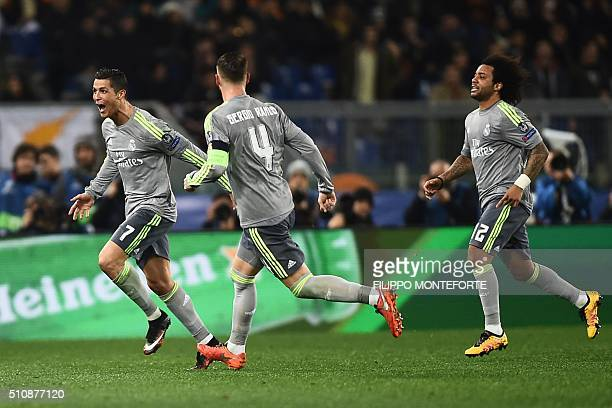 Real Madrid's Portuguese forward Cristiano Ronaldo celebrates with teammates Real Madrid's defender Sergio Ramos and Real Madrid's Brazilian defender...