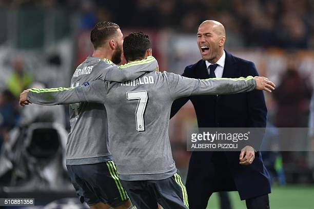 Real Madrid's Portuguese forward Cristiano Ronaldo celebrates with Real Madrid's defender Sergio Ramos and Real Madrid's French coach Zinedine Zidane...