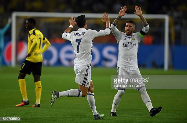Real Madrid's Portuguese forward Cristiano Ronaldo celebrates with Real Madrid's defender Sergio Ramos after his goal during the UEFA Champions...