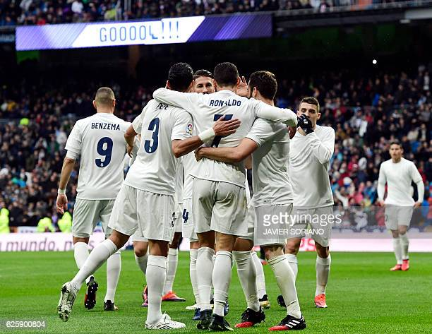 Real Madrid's Portuguese forward Cristiano Ronaldo celebrates with teammates his second goal during the Spanish league football match Real Madrid CF...