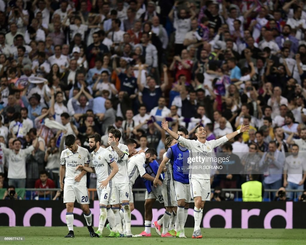 Real Madrid's Portuguese forward Cristiano Ronaldo celebrates with teammates during the UEFA Champions League quarter-final second leg football match Real Madrid vs FC Bayern Munich at the Santiago Bernabeu stadium in Madrid in Madrid on April 18, 2017. /
