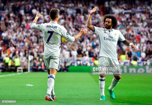 Real Madrid's Portuguese forward Cristiano Ronaldo celebrates with Real Madrid's Brazilian defender Marcelo after scoring during the UEFA Champions...