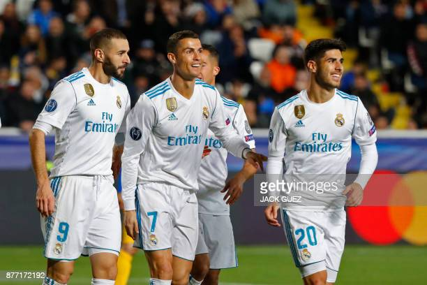 Real Madrid's Portuguese forward Cristiano Ronaldo celebrates with teammates his first goal and his team's fifth during the UEFA Champions League...