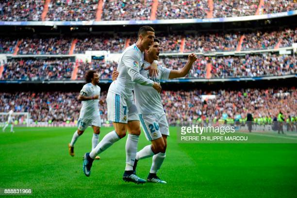 Real Madrid's Portuguese forward Cristiano Ronaldo celebrates with Real Madrid's Spanish midfielder Marco Asensio after scoring a goal during the...