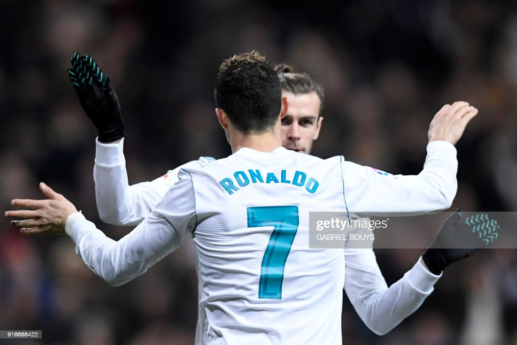 Real Madrid's Portuguese forward Cristiano Ronaldo celebrates with Real Madrid's Welsh forward Gareth Bale after scoring during the Spanish league football match between Real Madrid CF and Real Sociedad at the Santiago Bernabeu stadium in Madrid on February 10, 2018. /