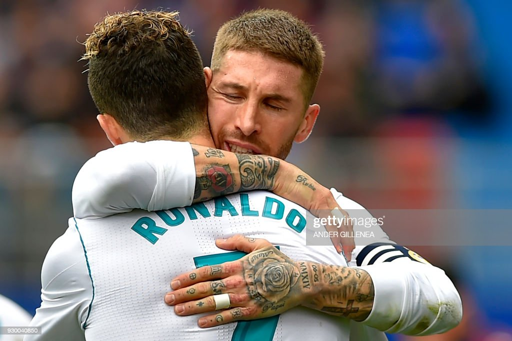 Real Madrid's Portuguese forward Cristiano Ronaldo celebrates with Real Madrid's Spanish defender Sergio Ramos (back) after scoring a goal during the Spanish league football match between Eibar and Real Madrid at the Ipurua stadium in Eibar on March 10, 2018. /