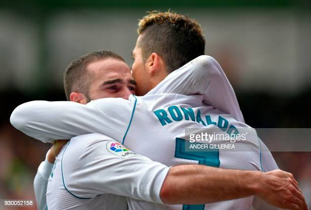 Real Madrid's Portuguese forward Cristiano Ronaldo celebrates with Real Madrid's Spanish defender Daniel Carvajal after scoring his team's second...
