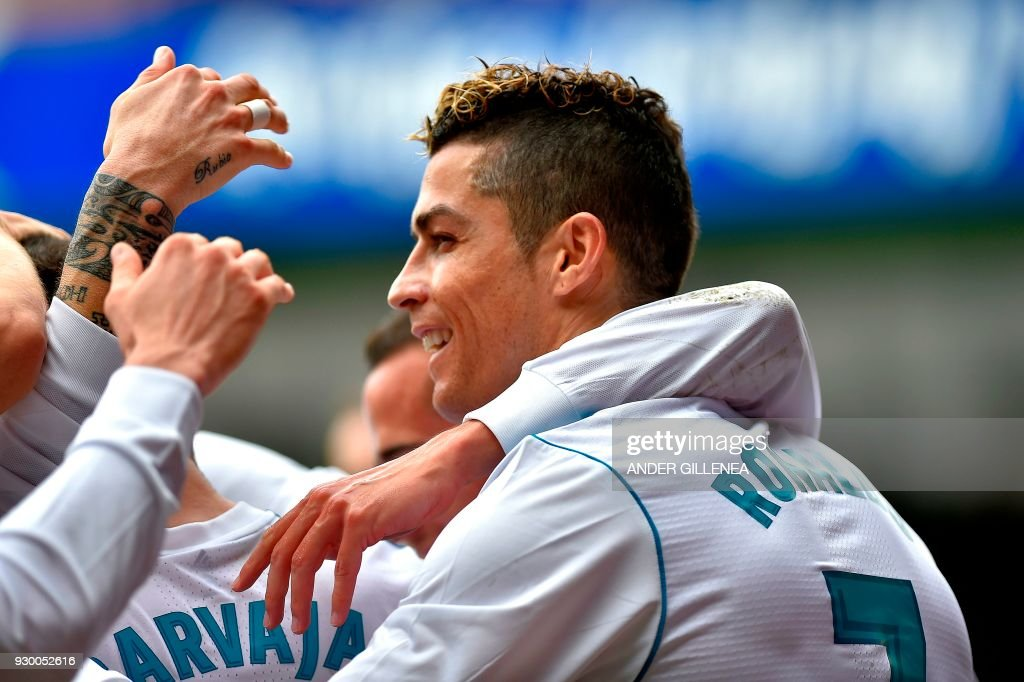 Real Madrid's Portuguese forward Cristiano Ronaldo celebrates with teammates after scoring his team's second goal during the Spanish league football match between Eibar and Real Madrid at the Ipurua stadium in Eibar on March 10, 2018. /