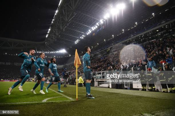 TOPSHOT Real Madrid's Portuguese forward Cristiano Ronaldo celebrates with teammates after scoring their second goal during the UEFA Champions League...