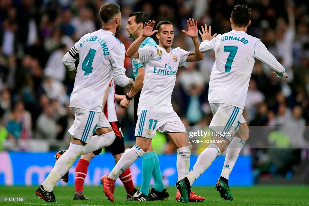Real Madrid's Portuguese forward Cristiano Ronaldo (R) celebrates with Real Madrid's Spanish midfielder Lucas Vazquez after scoring during the Spanish league football match Real Madrid CF against Athletic Club Bilbao at the Santiago Bernabeu stadium in adrid on April 18, 2018. /