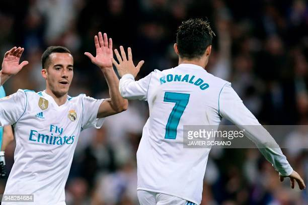 Real Madrid's Portuguese forward Cristiano Ronaldo celebrates with Real Madrid's Spanish midfielder Lucas Vazquez after scoring during the Spanish...
