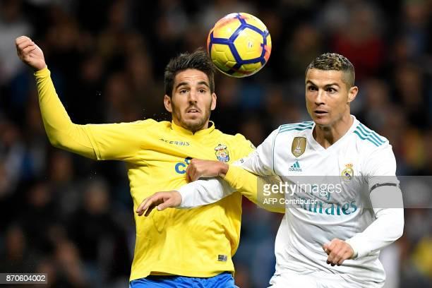 Real Madrid's Portuguese forward Cristiano Ronaldo challenges Las Palmas' Spanish defender Pedro Bigas Rigo during the Spanish league football match...