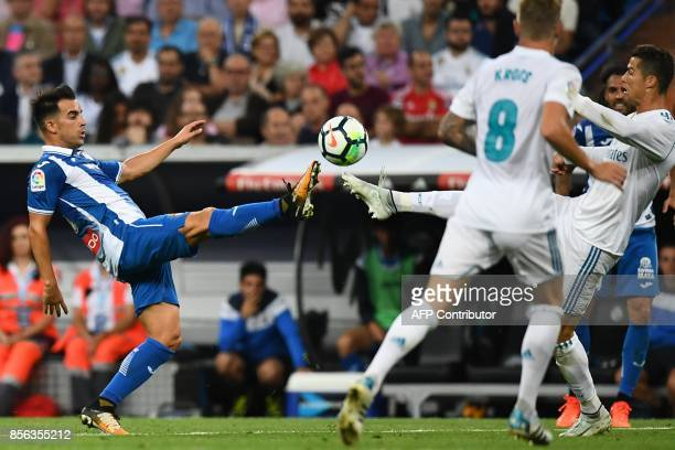 Real Madrid's Portuguese forward Cristiano Ronaldo challenges Espanyol's Spanish midfielder Jose Manuel Jurado during the Spanish league football...