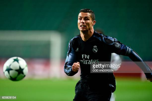 TOPSHOT Real Madrid's Portuguese forward Cristiano Ronaldo chases the ball during the UEFA Champions League group F football match Legia Warsaw vs...