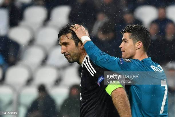 TOPSHOT Real Madrid's Portuguese forward Cristiano Ronaldo comforts Juventus' goalkeeper from Italy Gianluigi Buffon at the end of the UEFA Champions...