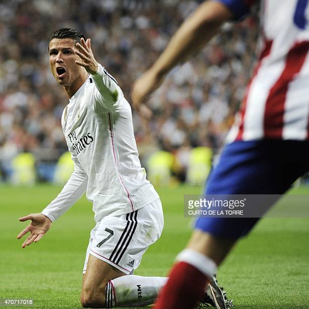 Real Madrid's portuguese forward Cristiano Ronaldo complains as he kneels on the ground during the UEFA Champions League quarterfinals second leg...