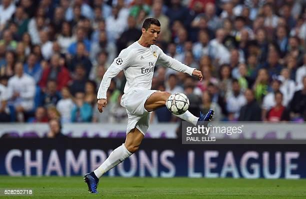 Real Madrid's Portuguese forward Cristiano Ronaldo controls a ball during the UEFA Champions League semifinal second leg football match Real Madrid...