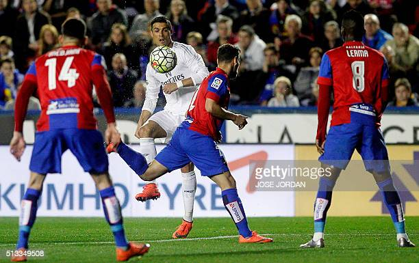 Real Madrid's Portuguese forward Cristiano Ronaldo controls te ball during the Spanish league football match Levante UD vs Real Madrid CF at the...