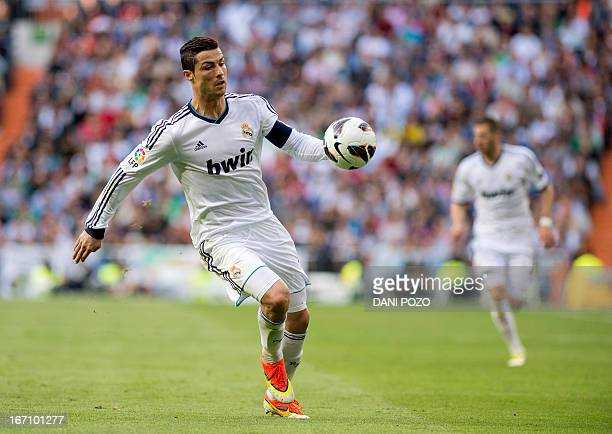 Real Madrid's Portuguese forward Cristiano Ronaldo controls the ball during the Spanish league football match Real Madrid CF vs Real Betis at the...