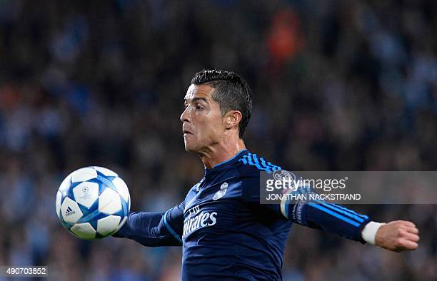 Real Madrid's Portuguese forward Cristiano Ronaldo controls the ball during the UEFA Champions League firstleg Group A football match between Malmo...