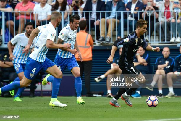 Real Madrid's Portuguese forward Cristiano Ronaldo controls the ball during the Spanish league football match Malaga CF vs Real Madrid CF at La...