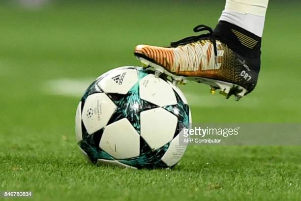 Real Madrid's Portuguese forward Cristiano Ronaldo controls the ball during the UEFA Champions League football match Real Madrid CF vs APOEL FC at...