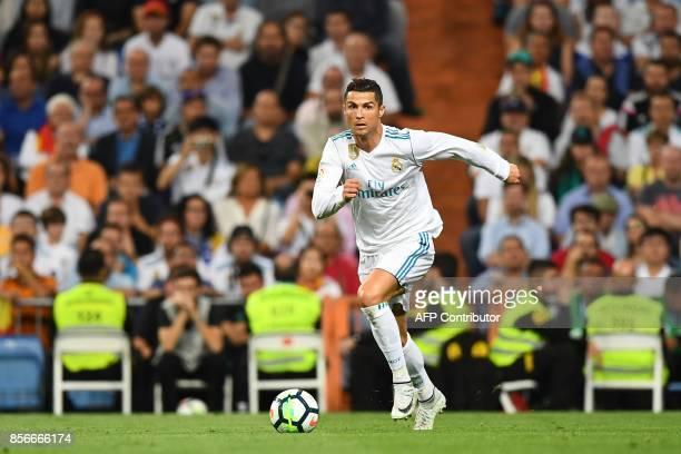 Real Madrid's Portuguese forward Cristiano Ronaldo controls the ball during the Spanish league football match Real Madrid CF vs Espanyol at the...