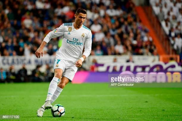Real Madrid's Portuguese forward Cristiano Ronaldo controls the ball during the Spanish league football match Real Madrid CF vs SD Eibar at the...