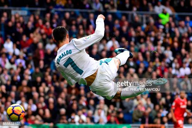 TOPSHOT Real Madrid's Portuguese forward Cristiano Ronaldo controls the ball during the Spanish league football match between Real Madrid and Sevilla...