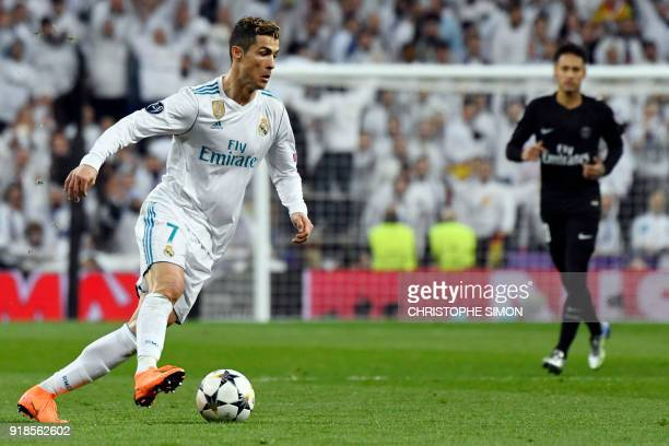 Real Madrid's Portuguese forward Cristiano Ronaldo controls the ball during the UEFA Champions League round of sixteen first leg football match Real...