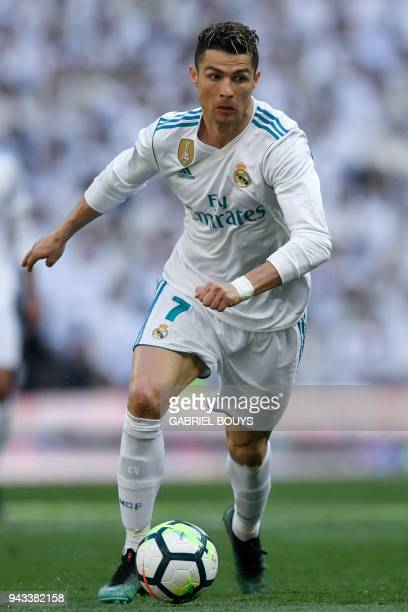 Real Madrid's Portuguese forward Cristiano Ronaldo controls the ball during the Spanish league football match between Real Madrid CF and Club...