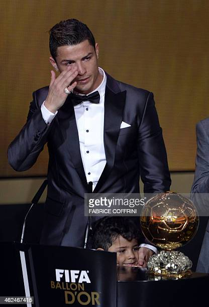 Real Madrid's Portuguese forward Cristiano Ronaldo cries after receiving the 2013 FIFA Ballon d'Or award for player of the year during the FIFA...