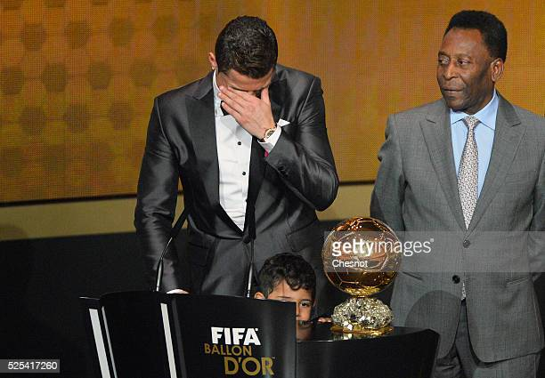 Real Madrid's Portuguese forward Cristiano Ronaldo cries after receiving the 2013 FIFA Ballon d'Or award for player of the year from Brazilian...