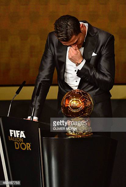 Real Madrid's Portuguese forward Cristiano Ronaldo cries as he accepts the 2013 FIFA Ballon d'Or award for player of the year during the FIFA Ballon...