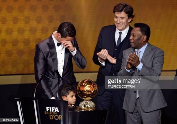 Real Madrid's Portuguese forward Cristiano Ronaldo cries next to his son Cristiano Ronaldo Junior after receiving the 2013 FIFA Ballon d'Or award for...