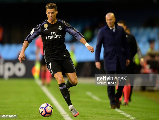 Real Madrid's Portuguese forward Cristiano Ronaldo drives the ball during the Spanish league football match RC Celta de Vigo vs Real Madrid CF at the...