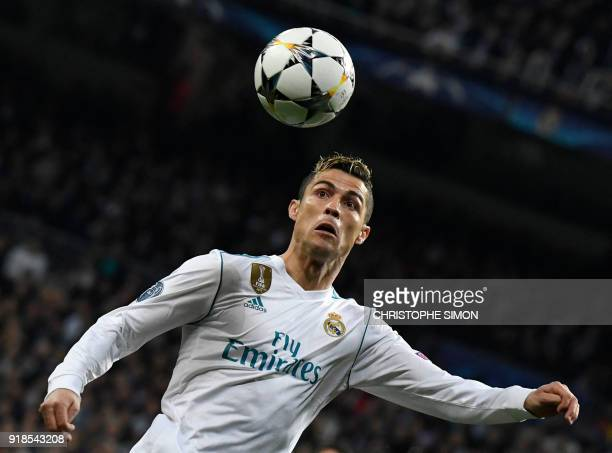 Real Madrid's Portuguese forward Cristiano Ronaldo eyes the ball during the UEFA Champions League round of sixteen first leg football match Real...