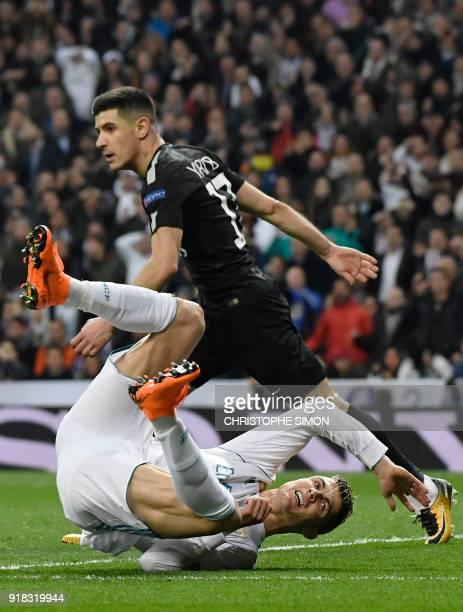 Real Madrid's Portuguese forward Cristiano Ronaldo falls down beside Paris SaintGermain's Spanish defender Yuri Berchiche during the UEFA Champions...
