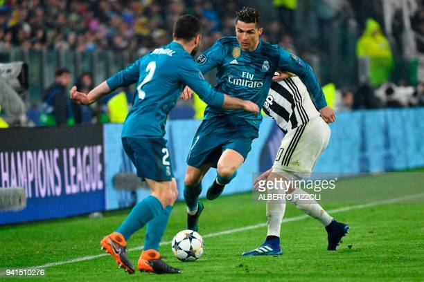 Real Madrid's Portuguese forward Cristiano Ronaldo fights for the ball with Juventus' midfielder from Uruguay Rodrigo Bentancur during the UEFA...