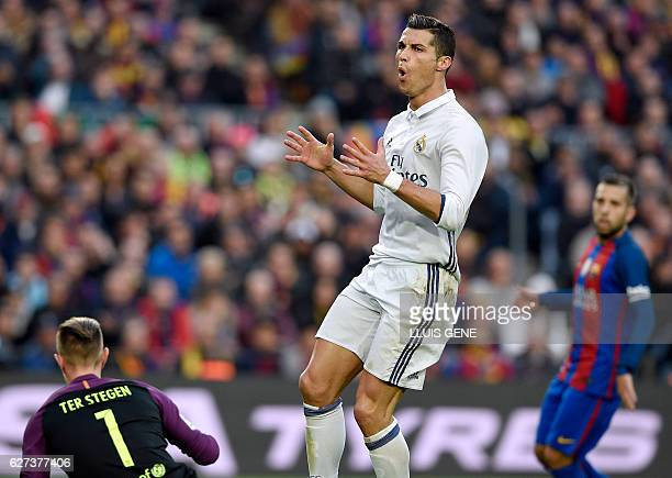 Real Madrid's Portuguese forward Cristiano Ronaldo gestures after missing a goal during the Spanish league football match FC Barcelona vs Real Madrid...