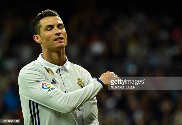 Real Madrid's Portuguese forward Cristiano Ronaldo gestures after missing a goal during the Spanish league footbal match Real Madrid CF vs Real Betis...
