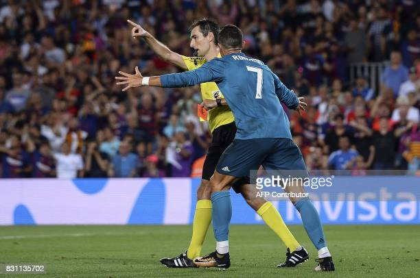Real Madrid's Portuguese forward Cristiano Ronaldo gestures after receiving a red card by referee Ricardo de Burgos Bengoetxea during the first leg...