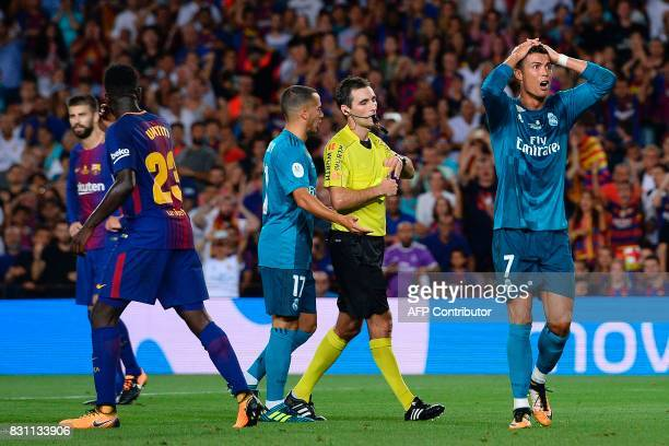 Real Madrid's Portuguese forward Cristiano Ronaldo gestures after receiving his second yellow card by referee Ricardo de Burgos Bengoetxea during the...