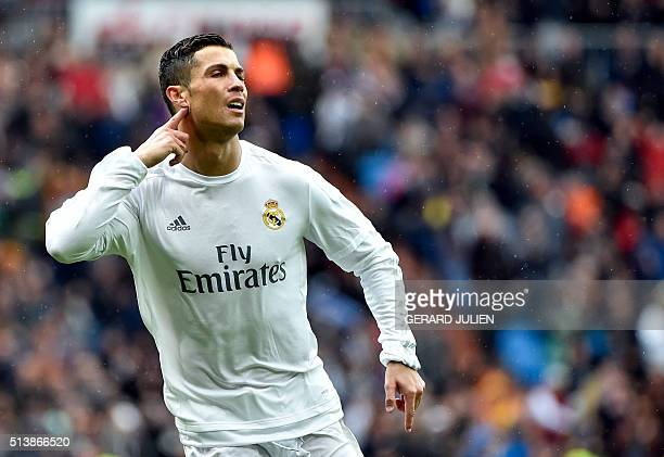 Real Madrid's Portuguese forward Cristiano Ronaldo gestures as he celebrates a goal during the Spanish league football match Real Madrid CF vs RC...